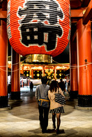 Couple walking under lantern at Sensoji